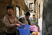 demolitian Hongkou, water tap, redevelopment area, living amongst demolished houses, migrant worker, living in demolished houses and self built shacks, slum, living amongst ruins