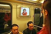 Metro Shanghai,Passangers, Passagiere, Fahrgäste, TV screen, advertising, Bildschirm mit Werbung, mass transportation system, subway, U-Bahn, modernes Verkehrsnetz, public transport, underground station, Bahnhof, commuters, Pendler
