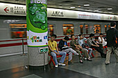 Metro Shanghai,mass transportation system, subway, public transport, underground station, waiting passengers, Werbeplakat, poster, People's Square, platform, commuters