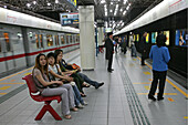 Metro Shanghai,mass transportation system, subway, public transport, underground station, waiting passengers, People's Square