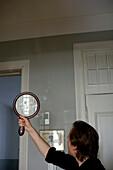 Man holding up a mirror, Upper Bavaria, Germany