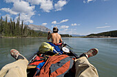 Relaxed rowing on South Nahanni River, Northwest Territories, Canada