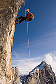 Climber abseiling from Raetikon Mountain, Switzerland