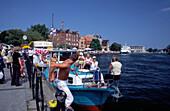 Tourists near Motlawa River in Gdansk, Danzig, Poland