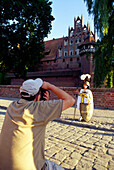Tourists in Castle of the Teutonic Knights in Malbork (13th - 14th century), Poland