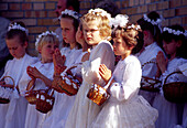 Young girls during the Procession on Flower Carpets for Corpus Christi in Spicimierz near Lodz, Poland