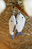Wooden fishes hanging on straw basket