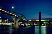Illuminated Millenium Bridge, River Thames, leading to Modern Tate Gallery, London, England