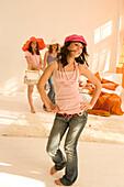 Teenage girls (14-16) posing like fashion models