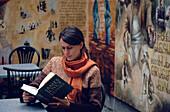 Girl reading Ulysses at James Joyce Centre, Dublin, Ireland