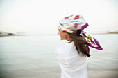 Young woman with headscarf, blurred motion
