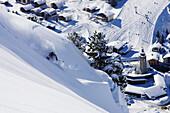 Man skiing downhill, Lech, Arlberg, Austria