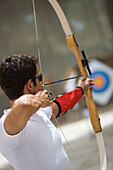 Archer taking aim at target, Apulia, Italy