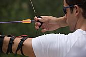 Archer taking aim at target