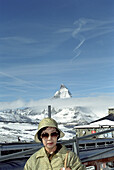 Asian tourist in front of the Matterhorn, Zermatt, Switzerland
