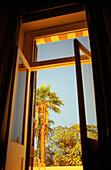 Open glazed door with outlook, Luxor, Egypt