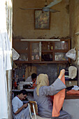 People working at a tailor shop, Luxor, Egypt
