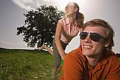 Couple having fun on meadow