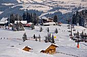 View over ski lift to Birkhahnalm and Griesskarhaus, Flachau, Salzburger Land, Austria