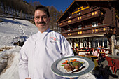 Chef Markus Riess serving a meal, Hotel and Restaurant Hohnegg, Saas-Fee, Valais, Switzerland