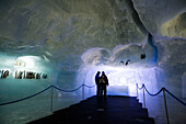 People visiting the world's biggest ice pavilion on Allalin, Saas-Fee, Valais, Switzerland
