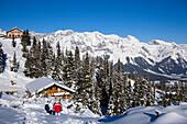Hiking between alpine huts (Hochwurzenalm), summit of the Dachsteinregion at horizon, Hochwurzen, Schladming, Ski Amade, Styria, Austria