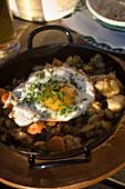 Regional delicacy (potato pan) served in restaurant, Schladming, Ski Amade, Austria