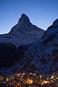 Illuminated Zermatt village with the Matterhorn (4478 metres) in the background at night, Zermatt, Valais, Switzerland