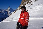 Ski instructor on mountain slope, Matterhorn (4478 m) in background, Rothorn, Zermatt, Valais, Switzerland