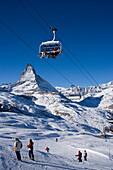 People on ski lift and slope, Matterhorn in background, Zermatt, Valais, Switzerland