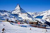 The Matterhorn and mountain railway lines on Riffelberg, Zermatt, Valais, Switzerland