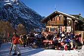 "People sitting on terrace of the mountain restaurant ""Othmar's Hütte"", Sunnegga Paradise, Zermatt, Valais, Switzerland"