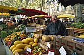 Woman at weekly market, Aix-en-Provence, Provence, France
