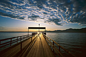 The main pier in the morning light, Fraueninsel, Lake Chiemsee, Bavaria, Germany