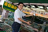 Man with Live Lobster,Chuen Kee Seafood Restaurant, Sai Kung, New Territories, Hong Kong