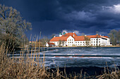 Seon Monastry with thunderstorm in spring and ice on the lake, Chiemgau, Upper Bavaria, Bavaria, Germany