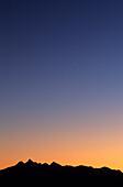 Silhouette of Glockner mountain range with Grossglockner in the twilight, Salzburg, Austria