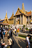 Tourists visiting Wat Phra Kaew, the most important Buddhist temple of Thailand, Ko Ratanakosin, Bangkok, Thailand