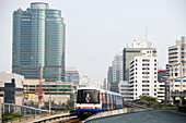 Sky Train passing Siam Square, Skyscrapers in background, Pathum Wan district, Bangkok, Thailand