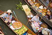 Women offering fruit at the Floating Market, Damnoen Saduak, near Bangkok, Ratchaburi, Thailand