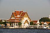 View over Chao Phraya River to Wat Rakang Kositharam, Thon Buri, Bangkok, Thailand