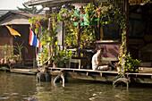 Wooden stilt houses along a Khlong, Thon Buri, Bangkok, Thailand