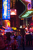 People strolling over Soi Cowboy with bars and nightclubs, red-light district, Th Sukhumvit, Bangkok, Thailand