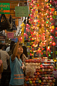 Young woman choosing a fairy lights at Suan Chatuchak Weekend Market, Bangkok, Thailand