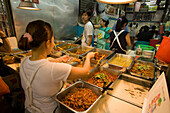 Women preparing Thai food at Suan Chatuchak Weekend Market, Bangkok, Thailand