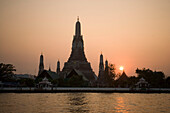 View over the river Menam Chao Phraya to Wat Arun, Temple of Dawn, Bangkok, Thailand