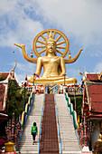 Tourists visiting gilded Big Buddha, 12 m, Wat Phra Yai, Ko Fan, Ko Samui, Thailand