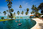 Vacationers relaxing at the swimming pool of the Napasai Hotel, Mae Nam Beach, Hat Mae Nam, Ko Samui, Thailand