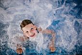 Young girl in whirlpool, Hotel Krallerhof, Leogang, Salzburger Land, Austria