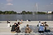 People sitting at Inner Alster Lake, Hamburg, Germany